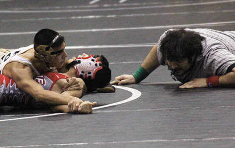 Wrestling team competing at State Dual Meet