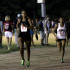 Madie Boreman runs in the girls 3200 race at Friday Night Lights. Boreman won the race.