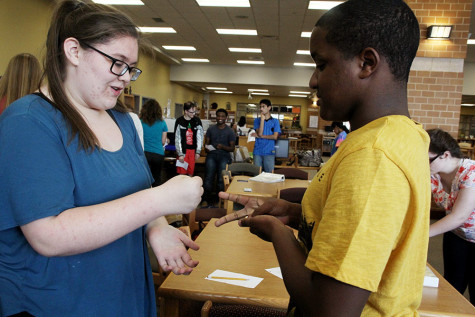 Bekah Turner and Earl Beechum play a game during ARC's meeting, Oct. 7.