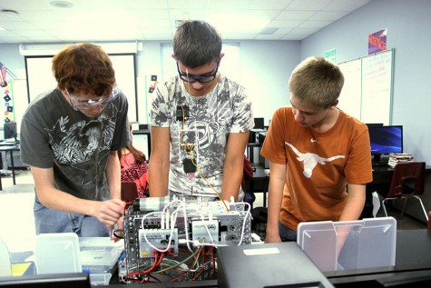 Robotics team builds, operates robots for competition