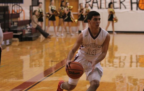 Varsity boys basketball ties for second, make playoffs