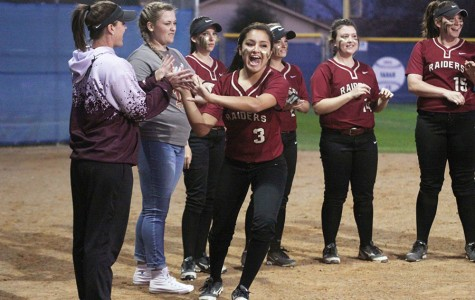 Varsity softball tied for second after first round of district