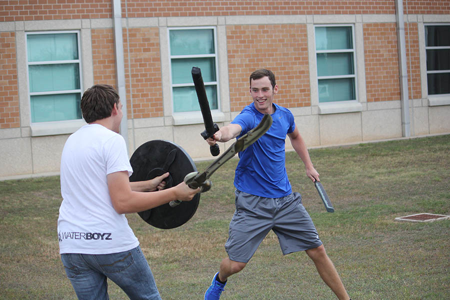 LARP club president Alex Bourland battles in front of the school during Advocate.