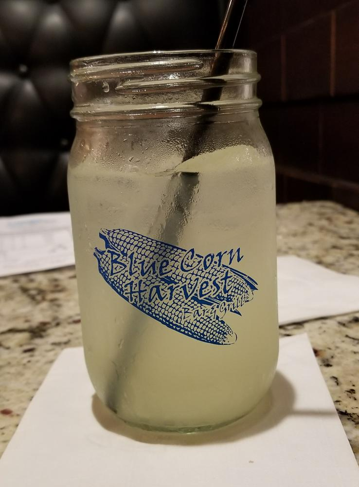 Blue Corn Harvest logo on a glass of lemonade