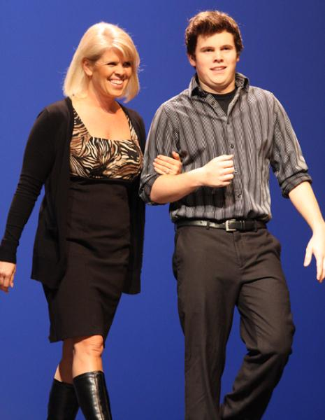 Senior Josh Companion escorts his mom onto the stage.
