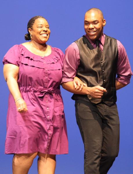 Senior Josh Bush escorts his mom ointo the stage.