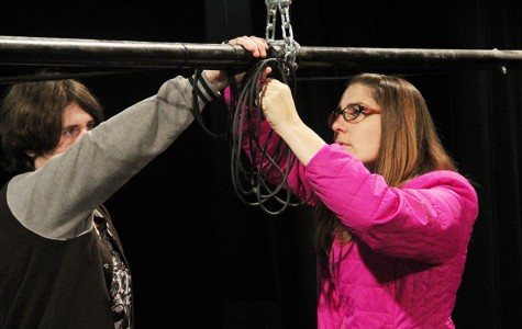Technical theatre students work behind the scenes for musical