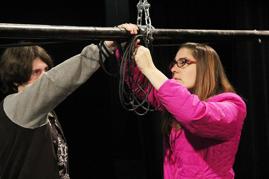 Corey Parker and Techinical Director Holly Flannery coil a wire for later use in the show.