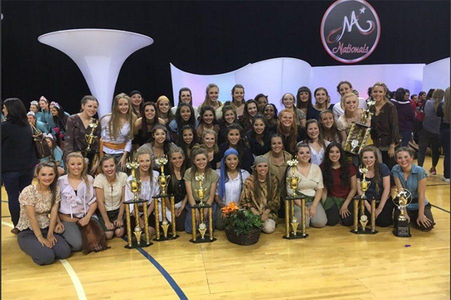 The Royals pose with their trophies after competing at the Marching Auxilaries Dance Contest, April 8-9.