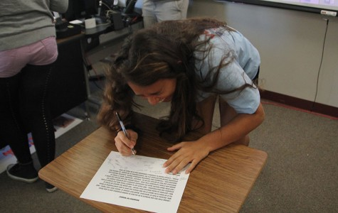 Students sign Resolution of Respect for C-squared, school