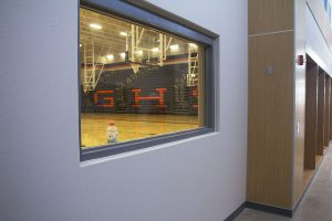 In the hallway across from the concession stand is a unique feature at the gym, a window looking onto the court. A narrow table will be added below the window to allow students to eat snacks and still watch the game.