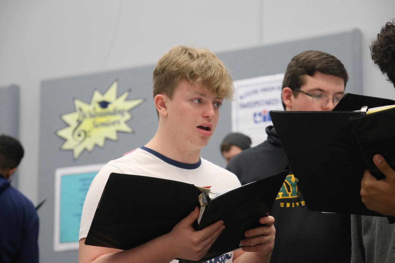 Senior Keaton Pugh rehearses his choir music under the direction of choir director Brenda Justice.