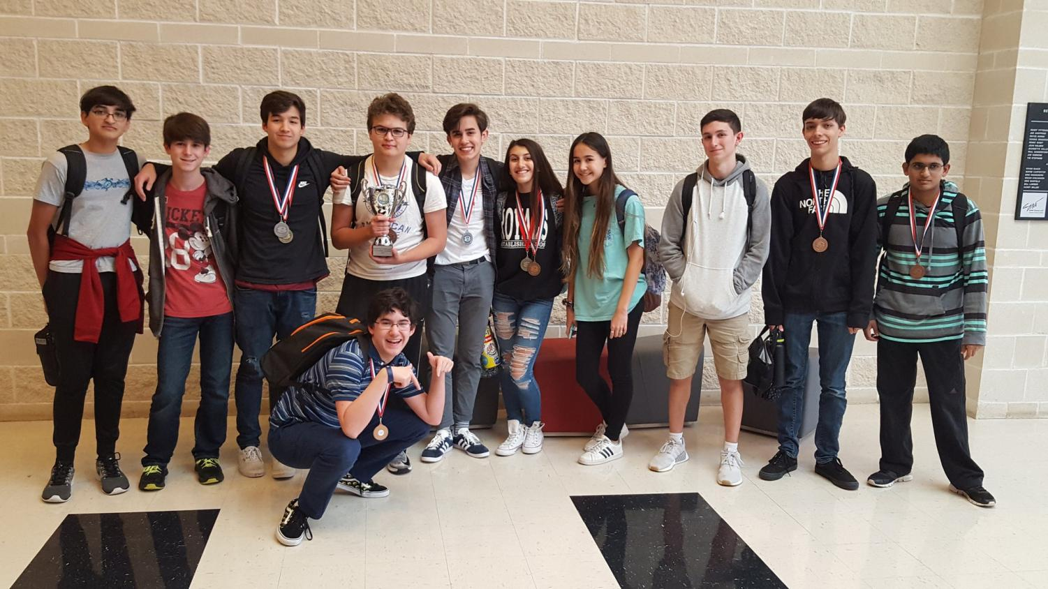 At their first practice meet Oct. 20 at Belton HS, several UIL academic team members take a picture with the medals they won. Students earned enough points in all events combined to bring home the Sweepstakes award.