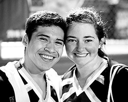 Seniors Drew Padilla and Jasmine King share a smile before the Hutto football game.