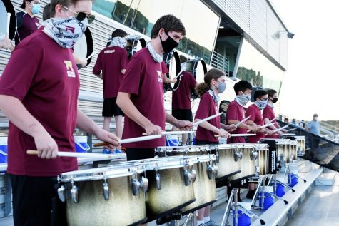 Drumline performs at the Friday night football game.
