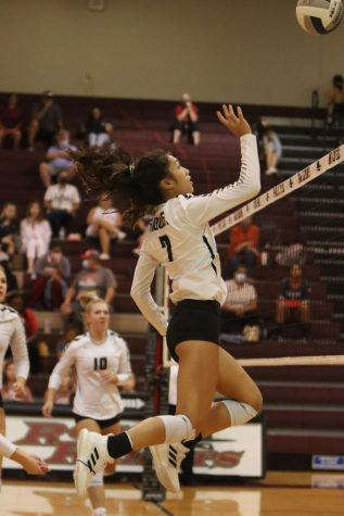 During the game against Flower Mound, junior Kayla Lopez jumps for the ball.